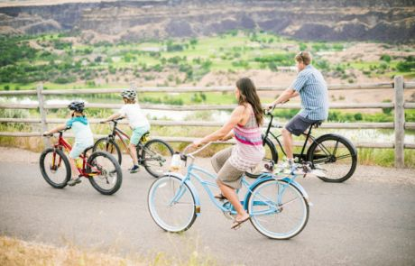 Idaho, Twin Falls. Family biking along canyon rim.